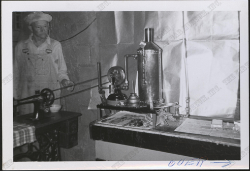 Harry W. McGee, Milwaukee, WI, ca: 1960, Photograph 1886 Sewing Machine Powered by Steam Engine 2, Nichols Collection, Front